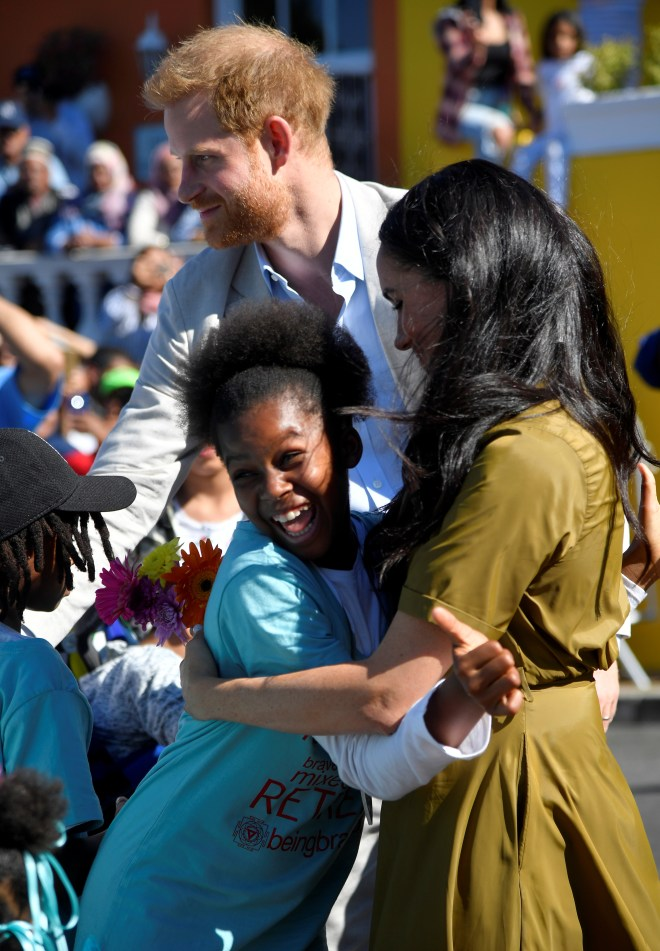 Meghan, 38, cuddled children on a walkabout in multi-cultural district Bo-Kaap