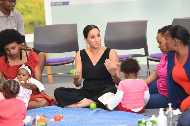 Meghan Markle sat with other mums during a visit to mothers2mothers in South Africa