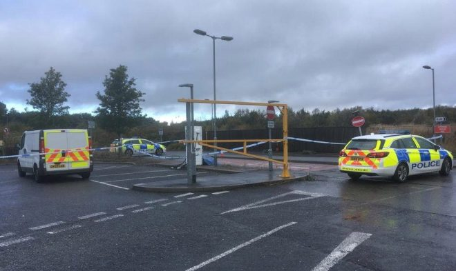 Police cordoned off the area the body was found at the Coachway in Milton Keynes