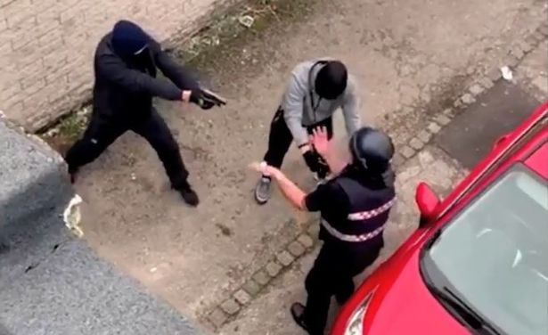 This is the moment a cash courier is begging for his life while staring down the barrel of a handgun