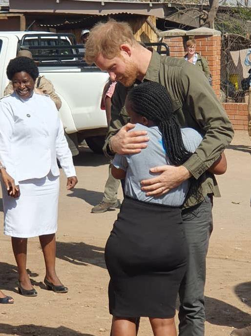 Prince Harry hugs Let Youth Lead advocate Tlotlo during his trip today