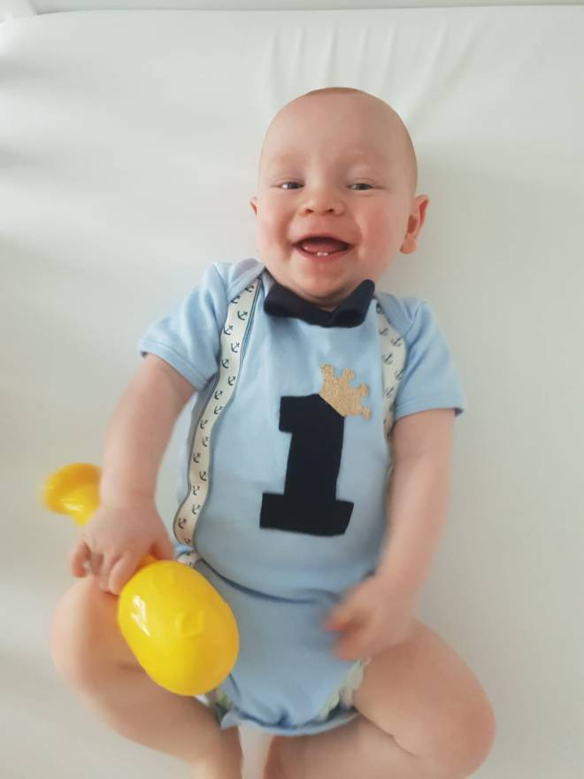 Little fighter Haris Mockbill looks a picture of health after beating all the odds to reach his first birthday