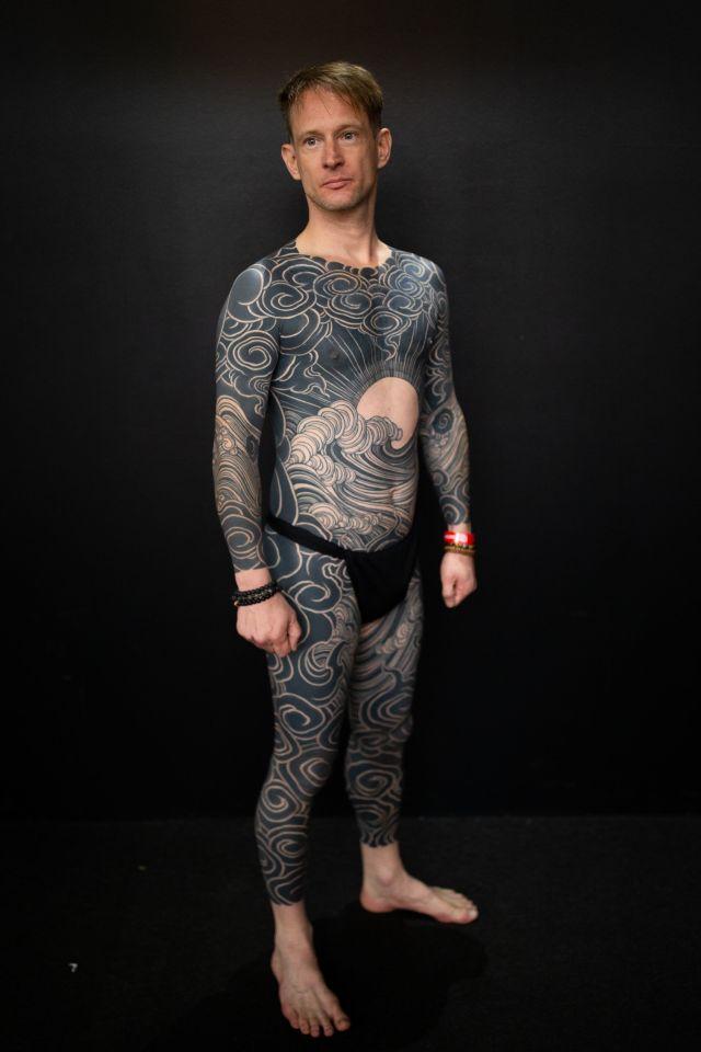 A man shows off his bodysuit