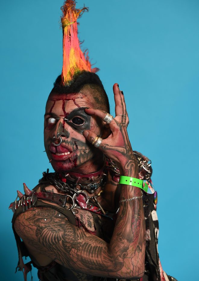 Zombie Punk, from Brazil, with ink on his arms, chest and body along with several facial piercings