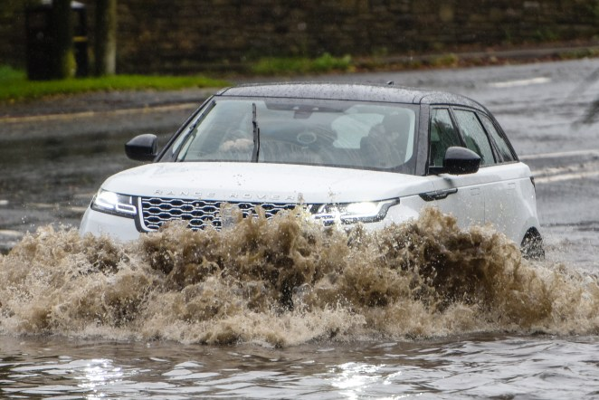 Intense downpours in Horwich, Greater Manchester yesterday, with drivers battling inches of floodwater