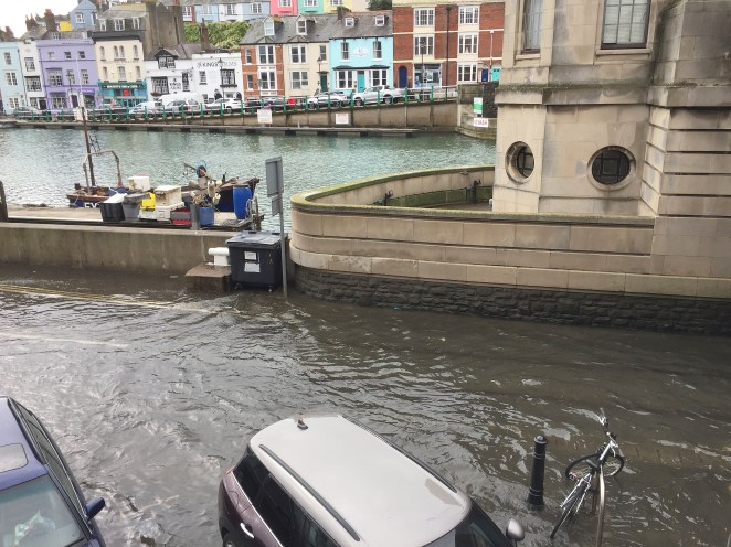 Dorset was battered by heavy rain and strong winds on Sunday, with roads completely flooded surrounding Weymouth Harbour