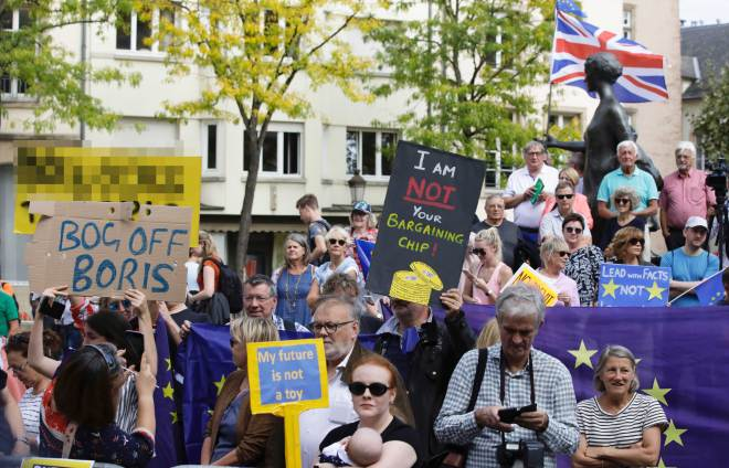 A crowd of Remainer protesters gathered outside the railings and bombarded the British PM with boos