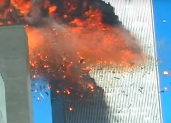 The clip captures the exact moment the second plane slams into the World Trade Center