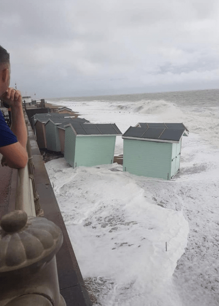 Beach huts being washed away in a storm at St Leonards-on-Sea on Sunday