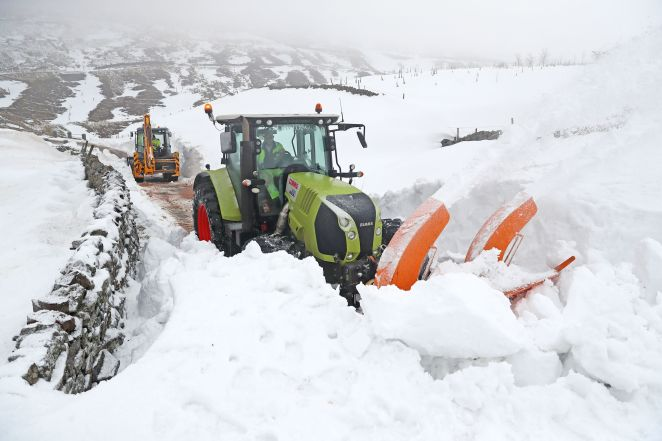 A snow blower in Nenthead, Cumbria trying to clear the road of snow in freezing weather conditions in March last year