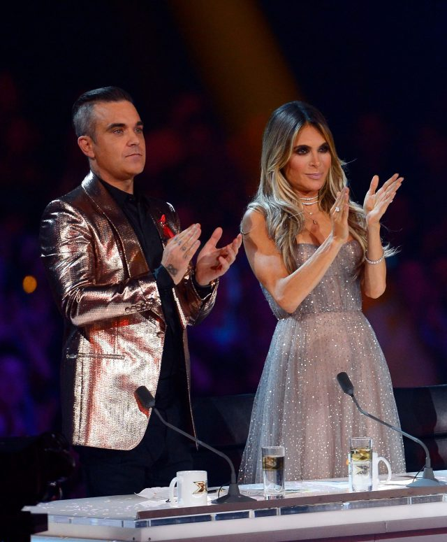 Louis slammed Robbie for 'bringing his wife to work'