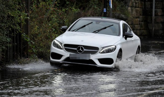 Motorists commute to work this morning through flooded roads in Gateshead