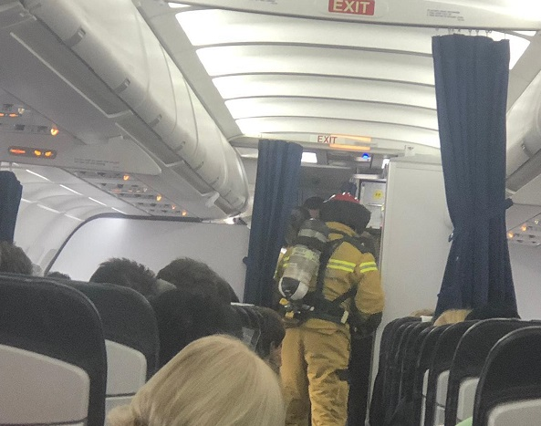 Pictures taken on board show the jet on the ground at where the pilot had made an emergency landing with with fire crews onboard as anxious passengers look on