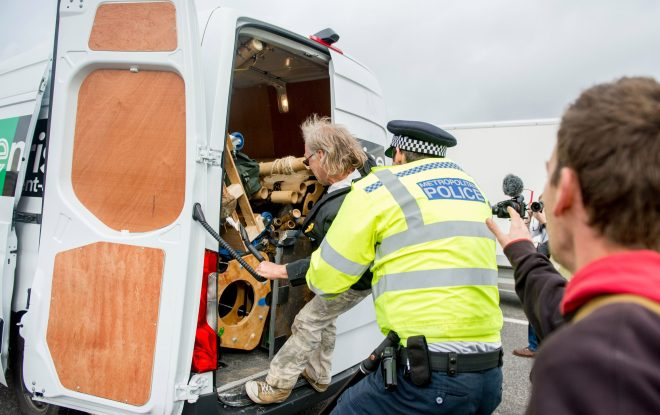 Activists tried to set up an action site with bamboo this morning on Westminster Bridge