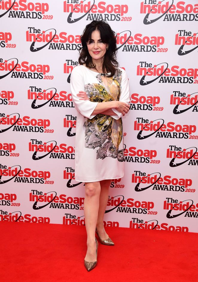 Sally Dexter wrapped up in a white dress with a colourful print