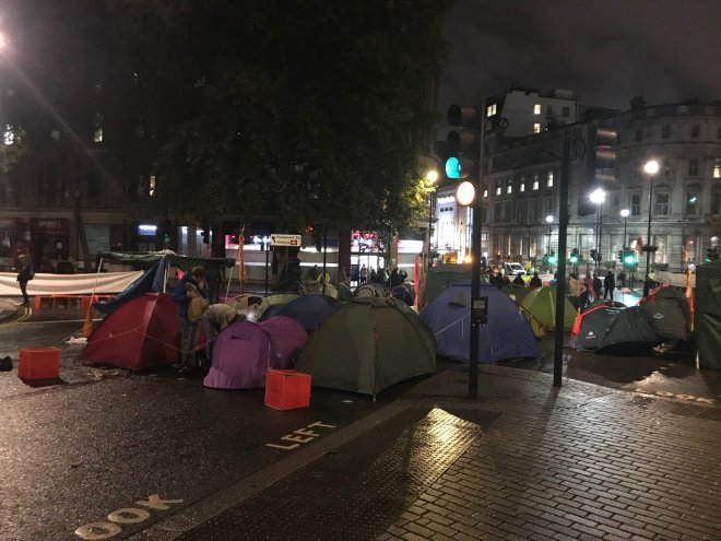 Protesters set up tents last night in Trafalgar Square
