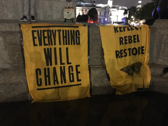 These signs were draped in on statues in Trafalgar Square last night