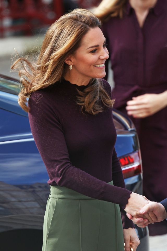 The Duchess of Cambridge smiles as she is greeted