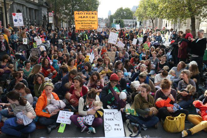 Nursing mothers with their children block Whitehall during the Extinction Rebellion mass 'nurse-in' road blockade