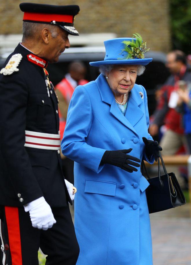The monarch visited the Haig Housing development near Morden, south London