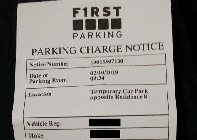 An emergency department worker who received two parking fines while undergoing surgery