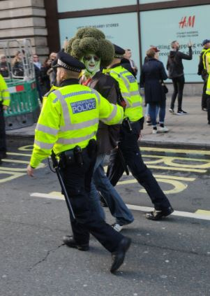 A man dressed as a broccoli was taken away from Bank by police this morning