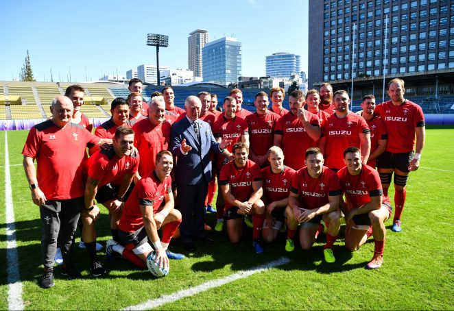 Prince Charles pictured with the members of the Wales rugby team while on his tour of Japan