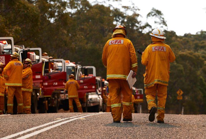 Rescue workers create fire breaks ahead of the Gospers Mountain bushfire in Sydney, Australia