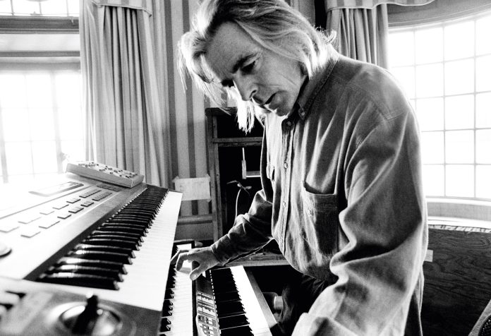 Richard Wright plays the keyboard on a houseboat in 1993