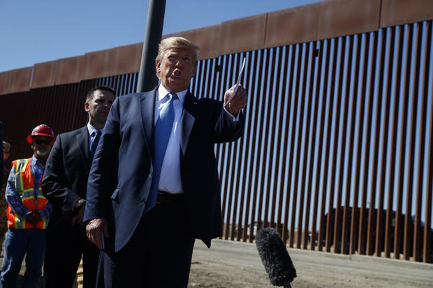 President Trump talks with reporters as he tours the same stretch of wall in Otay Mesa, California, in September