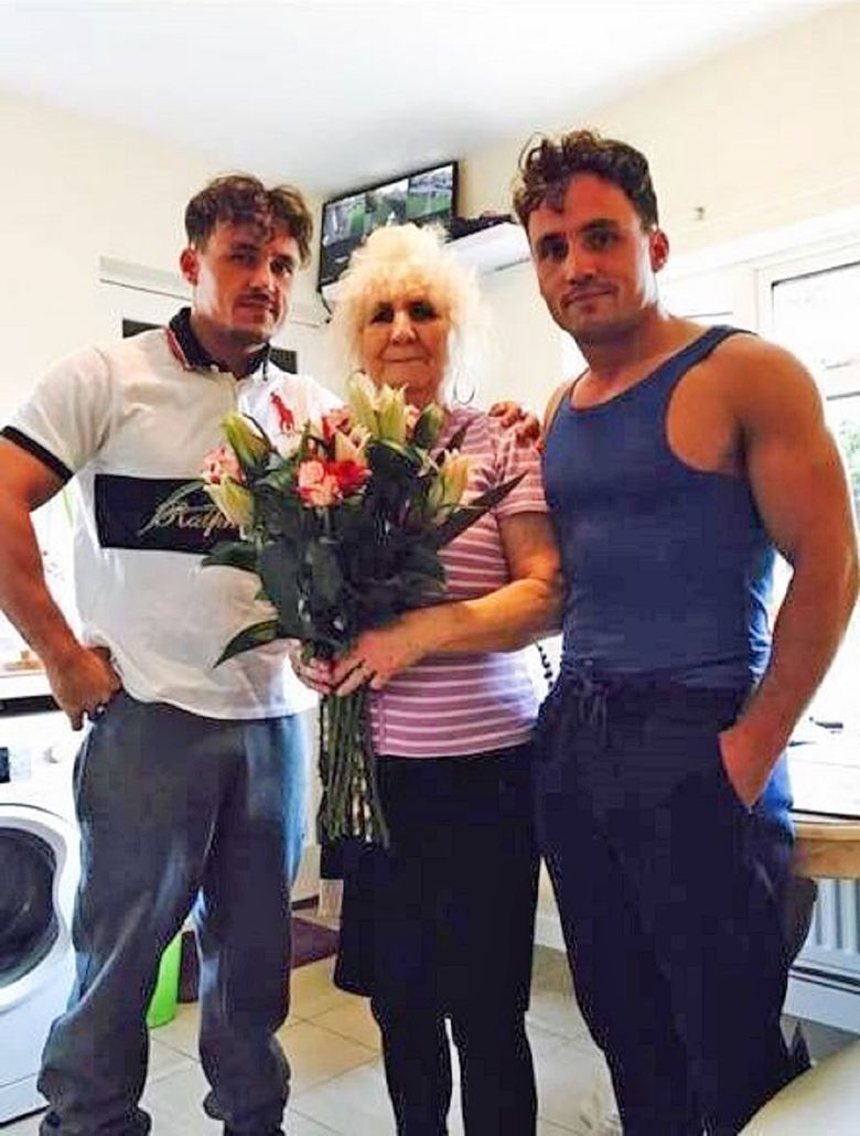 Billy and Joey Smith alongside their grandmother and posing for a picture
