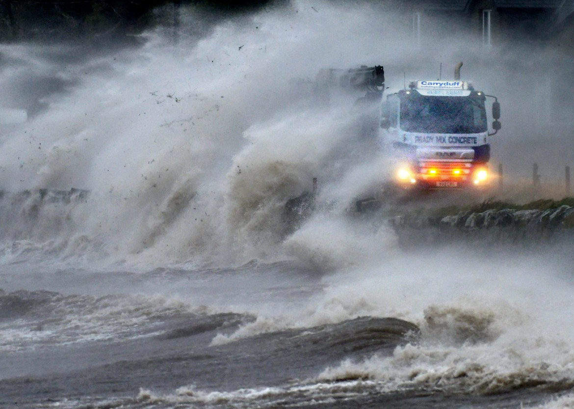 UK weather forecast: debris is transported to a truck as it travels along Strangford Lough seafront
