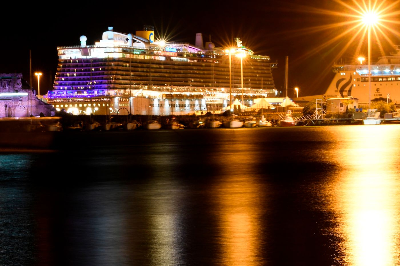 The Costa Smeralda cruise shop docked in the Civitavecchia port for the evening