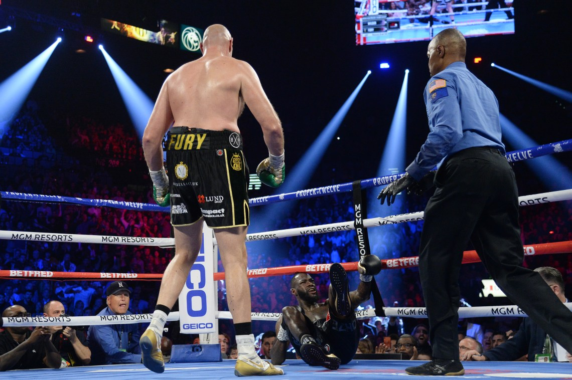 Tyson Fury knocked Deontay Wilder in the third round to send the crowd wild