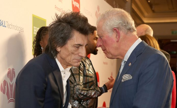 Prince Charles greets Rolling Stone Ronnie Wood as he attends the Prince's Trust