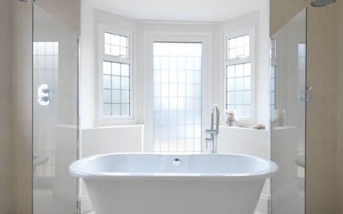 There is a freestanding bath in the main bathroom