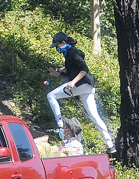 Meghan Markle was seen wearing shades, a baseball cap, white trousers and a black top
