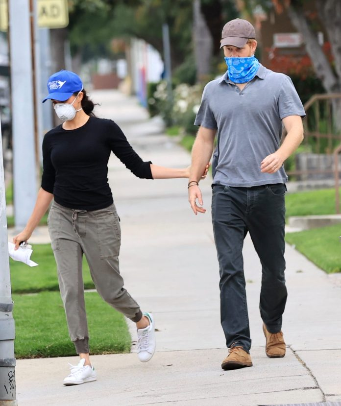The two were seen wearing masks to deliver babies in their new city