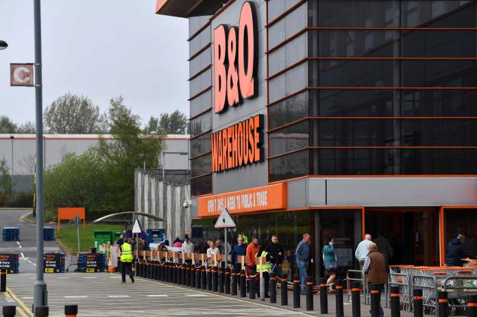 Buyers are seen outside a B&Q in Stoke-on-Trent, Staffordshire