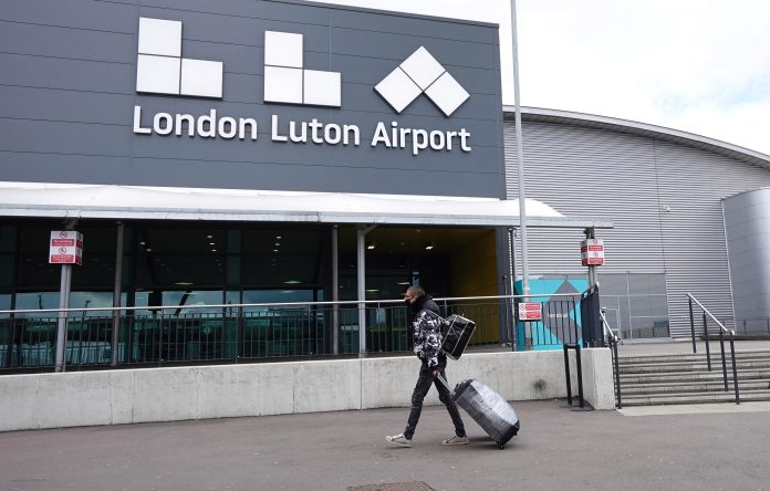 People arrived in Luton today for the first overseas flights