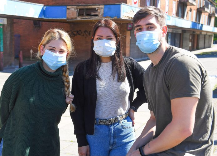 (L to R) Anna Mendoza, Javier Saez & Lorena Ramirez who have just bought face masks, in the Broughton district of Salford