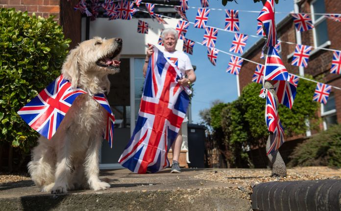 Bruno Peek and his dog Wilson prepare to celebrate the 75th anniversary of VE Day at home in Norfolk