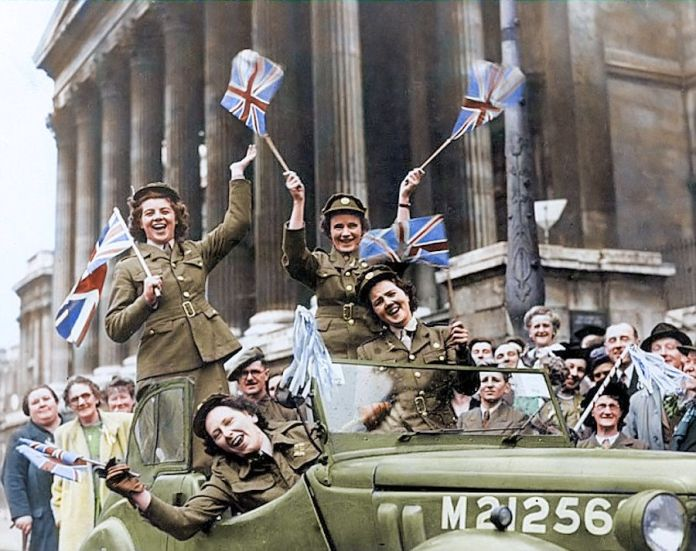 Members of the Auxiliary Territorial Service crossing Trafalgar Square in a service vehicle during the Victory Day celebrations in 1945