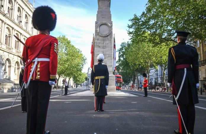 Members of the armed forces photographed during a service at the Whitehall Cenotaph this morning