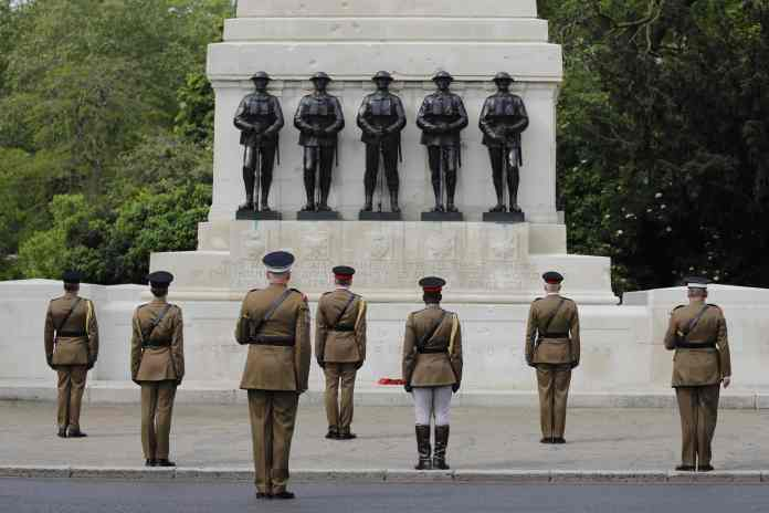 Household Division officers and soldiers observe social distance as they remain silent at Horse Guards Parade in St James's Park today