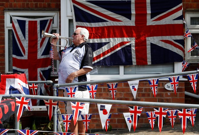 Mick Wells plays The Last Post outside his home in Leicestershire before the start of two minutes of silence