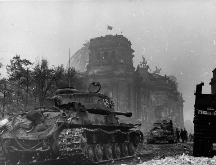 The Red Flag was flying above the Reichstag when large Russian tanks rolled up Berlin, which read 'Combat Girlfriend'