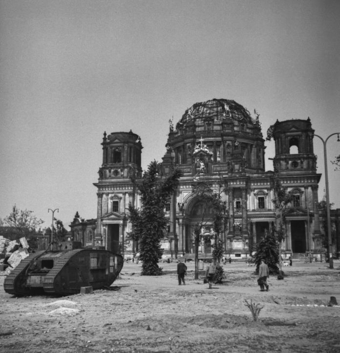 The first Mark V tank in the world standing left outside the Berlin Cathedral bomb ruins (Berliner Dom)