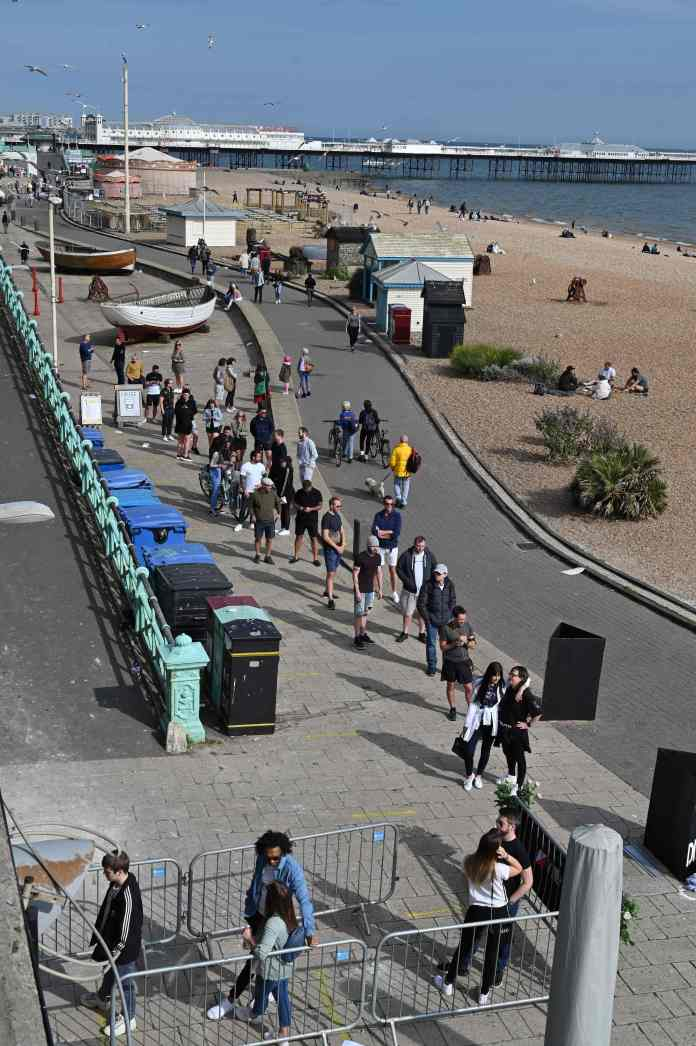 People queuing for beer on Brighton seafront following a loosening of lock rules
