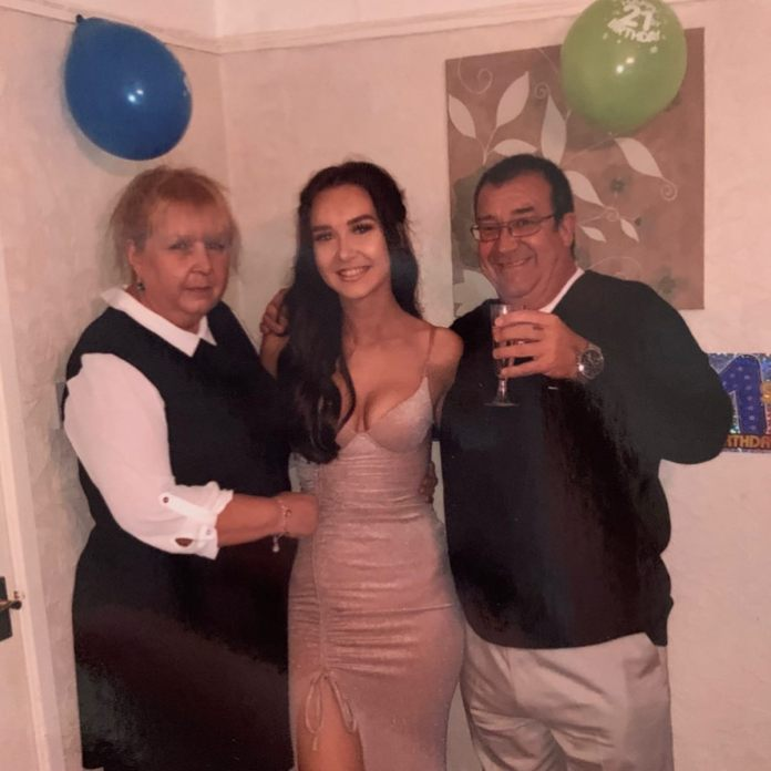 Lauren Hughes with her parents, Tine and Paul, who unfortunately died on April 16
